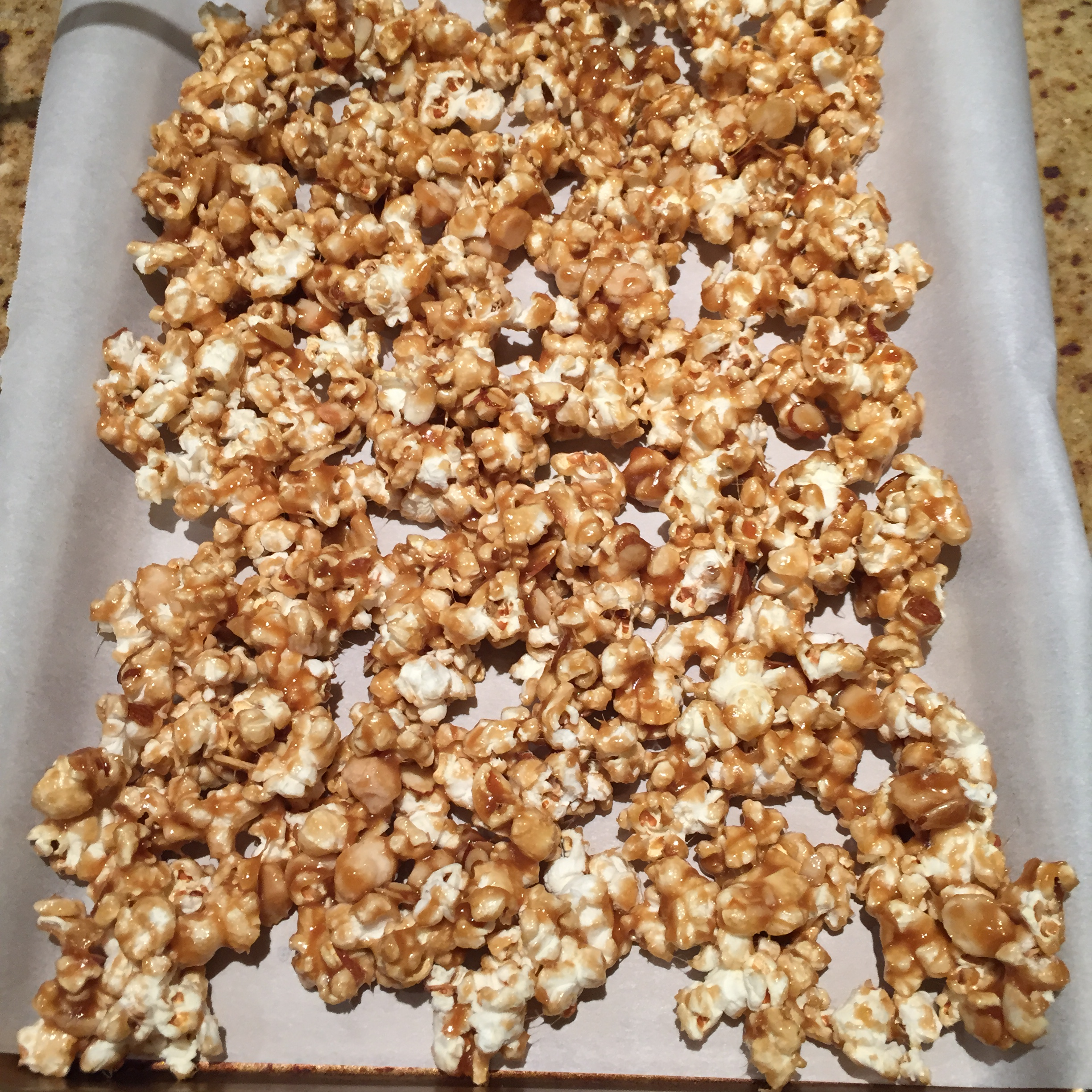 Spread the popcorn onto a baking sheet and bake for about 30 minutes